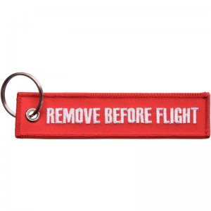 "EH 4217.: Nastri di avvertenza ‒ woven, embroidered with lettering ""Remove Before Flight"""